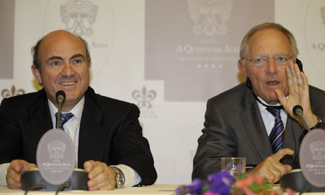 German Finance Minister Wolfgang Schauble (R) with Spanish Minister of Economy Luis de Guindo.