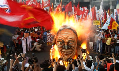 Protesters burn an effigy of Philippine President Benigno Aquino III on international Labour Day.