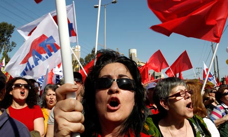 Greek Communist party supporters take part in a May Day protest in  Aspropyrgos, Athen
