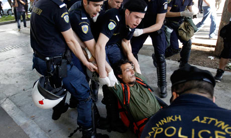Police detain a protester from central Syntagma square in Athens