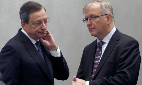 Mario Draghi (L) and Olli Rehn (R) at the start of the ECB meeting in Barcelona.