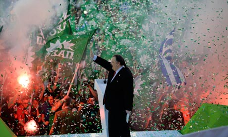 Greek Socialist party leader Evangelos Venizelos waves to supporters during a rally in Athens
