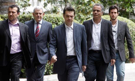 Syriza leader Alexis Tsipras leaves the Athens presidential palace.