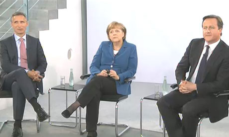 David Cameron and Angela Merkel at a Town Hall meeting in Berlin.