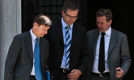 EU and IMF officials leave the Greek presidential palace.