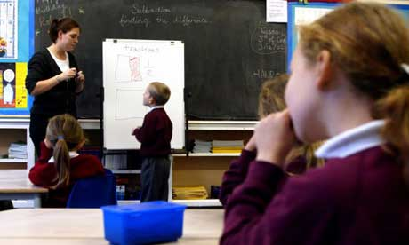 A teacher giving a maths lesson to pupils at Laindon Park primary school, Laindon, Essex