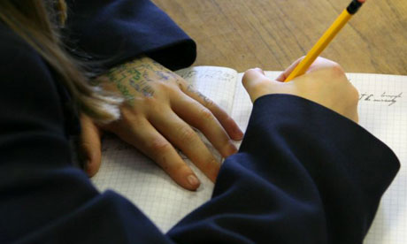 A pupil with writing on her hand in a year 7 maths lesson, at Shenfield High School, Brentwood, Essex. Photograph: Graham Turner/Guardian