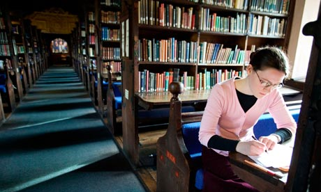 A student working in the library at Corpus Christi College Oxford University