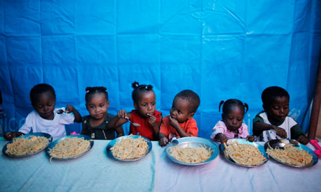 MDG : World disaster report : Children eat at the Notre Dame orphanage in Port-au-Prince
