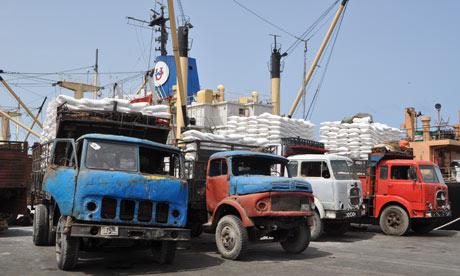 MDG : Somalia : Dilapidated trucks at Mogadishu's port