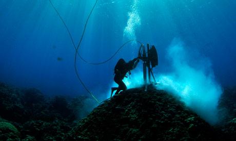Australian marine scientists examine coral cores at Clerke Reef, Western Australia