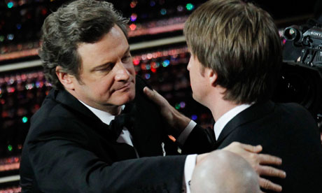 Oscars 2011: Colin Firth hugs Tom Hooper