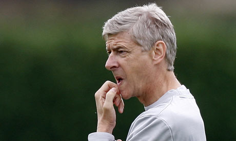 Arsenal's manager Arsene Wenger watches his players during a training session at London Colney