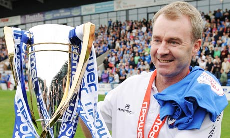 Chesterfield manager John Sheridan with the League Two trophy