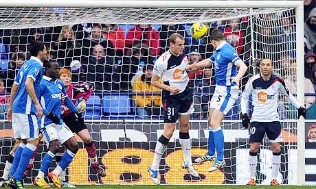 Gary Caldwell of Wigan scores against Bolton