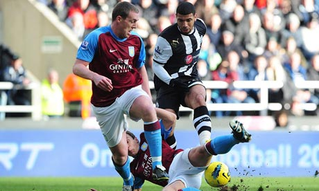Newcastle Leon Best has a shot blocked by Aston Villa's Stephen Warnock