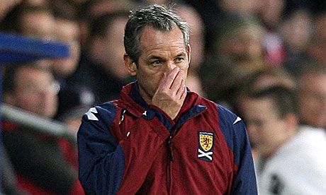 George Burley looks on during Scotland's humbling by Wales
