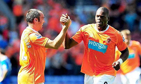 Blackpool's Marlon Harewood celebrates scoring his sides third goal against Wigan