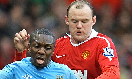 Shaun Wright-Phillips vies with Manchester United's Wayne Rooney
