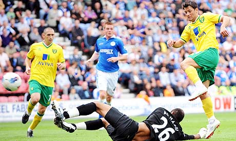 Norwich's Wes Hoolahan slots the ball past Wigan goalkeeper Ali Al Habsi at the DW Stadium.