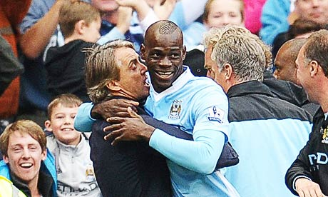 Manchester City's Mario Balotelli celebrates his goal against Everton with Roberto Mancini