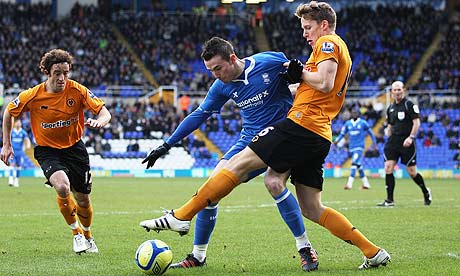 Jordon Mutch is challenged by Christophe Berra