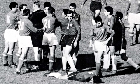 Aston tries to bring order after fighting breaks out. Chile's Sánchez, 11, lies injured after an Italy foul.