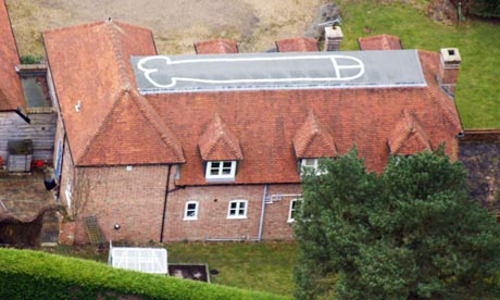 A house, near Hungerford, that has had a penis painted on its roof