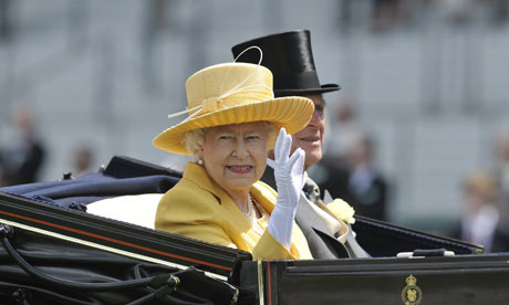 Queen Elizabeth and Prince Philip drive along the course at the Royal Ascot.