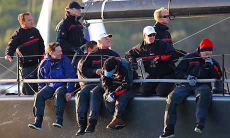 Crew aboard the yacht belonging to BP chief executive Tony Hayward (standing, in black cap)
