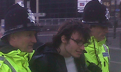 Police lead away a protester as David Cameron's motorcade leaves Newcastle's Centre for Life.