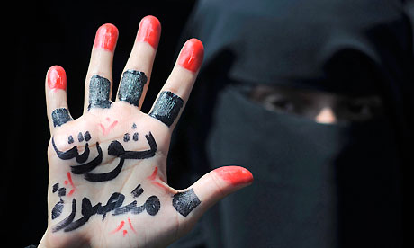 Sanaa, Yemen: A woman displays a message written on her hand