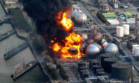 Natural gas storage tanks alight at the Cosmo oil refinery in Ichihara near Tokyo