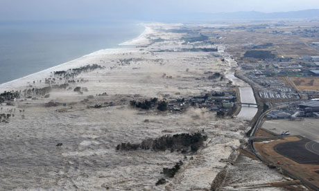 Earthquake-triggered tsumanis sweep along the shore in Iwanuma, northern Japan