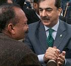 Pakistan's prime minister, Yusuf Raza Gilani, consoles relatives of Shahbaz Bhatti