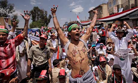 Anti-government protestors shout slogans during a demonstration in Yemen