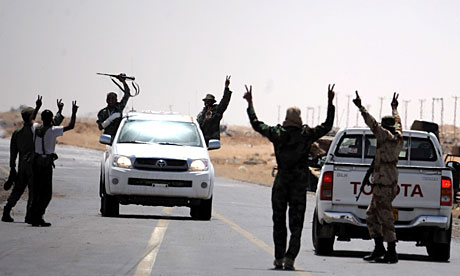 Libyan rebel fighters at a checkpoint between Ajdabiya and Brega.