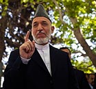 Afghan President Hamid Karzai interacts with members of the media after a news conference in Kabul
