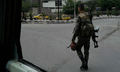 Syrian soldier patrols in Damascus