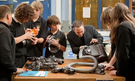 Teacher David Elton at Malmesbury school gets to grips with a Dyson vacuum cleaner with yr 9 pupils