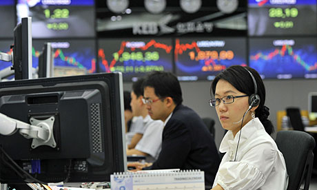 Currency traders monitor exchange rates in a dealing room at the Korea Exchange Bank in Seoul.