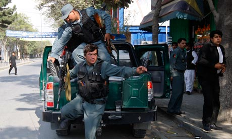Policemen arrive at the site of a rocket-propelled attack in Kabul, Afghanistan