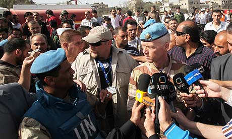 The head of the UN mission, Robert Mood (r), speaks to reporters in Damascus