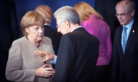 German chancellor Angela Merkel talks with Italy's prime minister Mario Monti at the EU summit