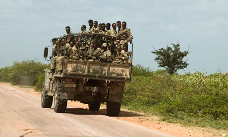 Ethiopian soldiers ride an army vehicle