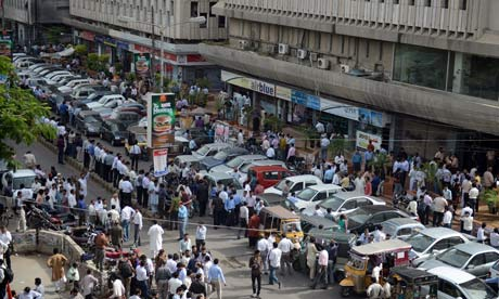 People are evacuated from buildings following tremors in Karachi