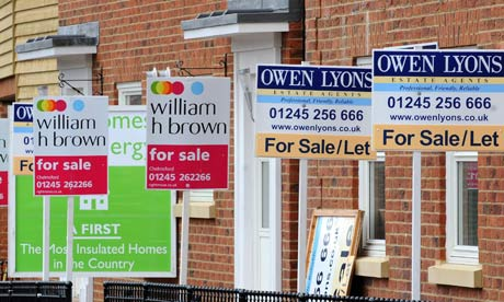 For sale signs on row of houses