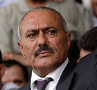 Yemen's President Ali Abdullah Saleh waves to supporters