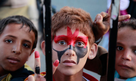 Boys take part in a rally to celebrate the departure of Yemen's President Ali Abdullah Saleh