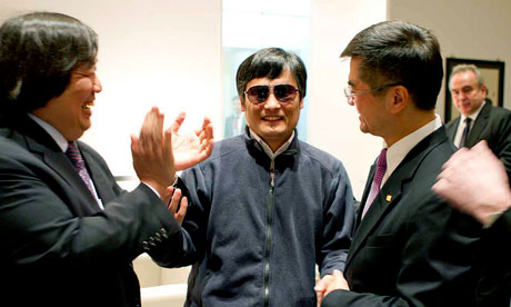 Chen Guangcheng holds hands with US ambassador to China